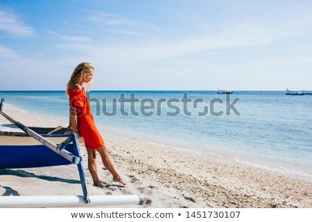 serious young blonde lady standing with eyes closed outdoors stock photo © deandrobot