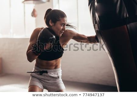 Boxoló képzés homokzsák portré rúgás kéz Stock fotó © deandrobot