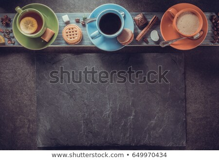 Tea, spices and cookies on wooden plank Stock photo © wavebreak_media
