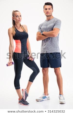 Muscular hombre pie los brazos cruzados crossfit gimnasio Foto stock © wavebreak_media