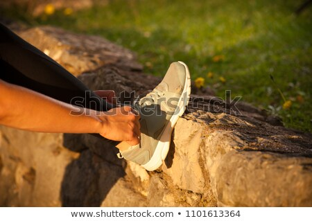 Woman runner doing up shoe lace Stock photo © IS2