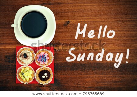 Hello Sunday! Cup of tea or coffee and four cupcakes on brown ta Stock photo © Nobilior