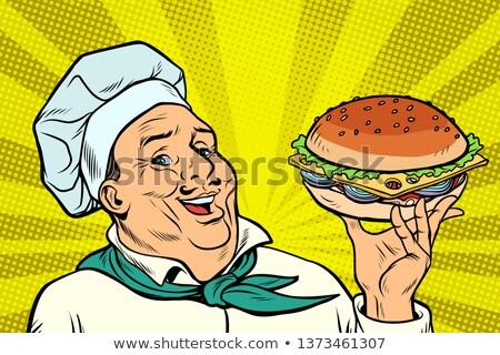 cook chef man presentation gesture hamburger stock photo © studiostoks
