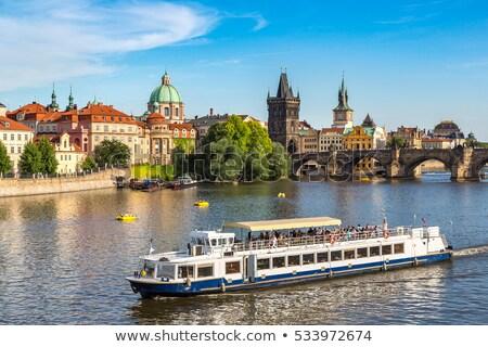 turisztikai · csónak · Prága · híd · égbolt · víz - stock fotó © givaga