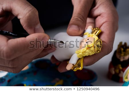 man painting figurines of a nativity scene Stock photo © nito