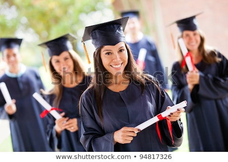 Hispanic Male With Deploma Wearing Graduation Cap and Gown Isola Stock photo © feverpitch