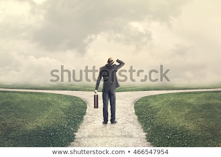 Businessman with two choices Stock photo © ra2studio