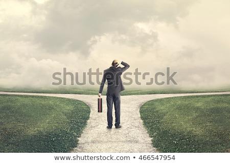 üzletember · kettő · lehetőségek · fiatal · választ · irányok - stock fotó © ra2studio