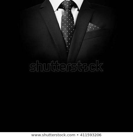 portrait of young attractive businessman buttoning suit Stock photo © feedough