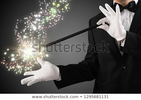 Close-up Of A Magician Creating Sparkles With Magic Wand Stock photo © AndreyPopov