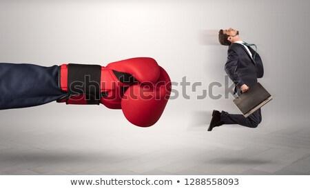 Big boss kicking little employee Stock photo © ra2studio