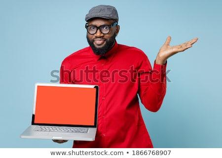 Elégedetlen szakállas férfi póló szemüveg tart Stock fotó © deandrobot