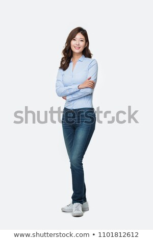 portrait of a happy casual asian woman standing stock photo © deandrobot