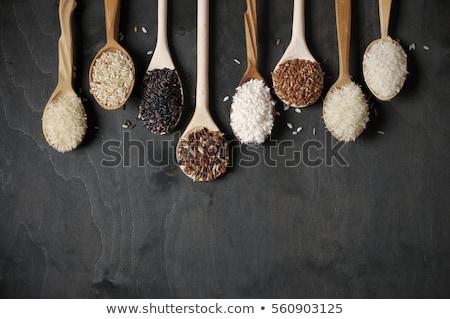 Raw rice grain. Organic food background. Ear of rice or ear of paddy. Golden spike rice. Field with  Stock photo © galitskaya