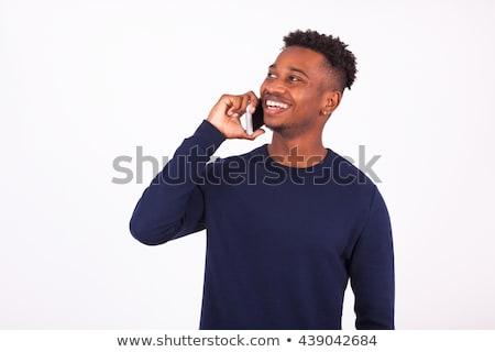 Mosolyog fürtös üzletember beszél okostelefon iszik Stock fotó © deandrobot