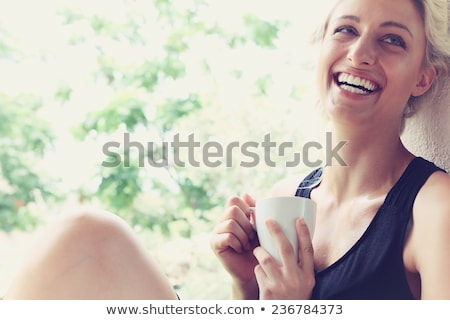 young pretty woman drinking her morning coffee at kitchen stock photo © dashapetrenko
