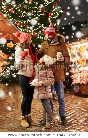 woman with coffee over christmas tree in tallinn Stock photo © dolgachov