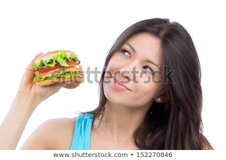 Túlsúlyos nő tart hamburger kéz kilátás Stock fotó © AndreyPopov