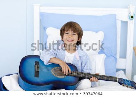 Feliz pequeno menino jogar guitarra sessão Foto stock © Lopolo