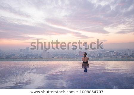 felső · kilátás · fiatalok · pihen · úszómedence · habfürdő - stock fotó © jossdiim