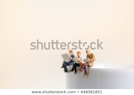close up of friendly man relaxing and reading a book stock photo © lichtmeister
