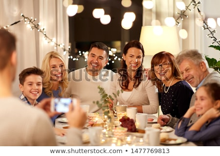 happy family with smartphone at tea party at home Stock photo © dolgachov