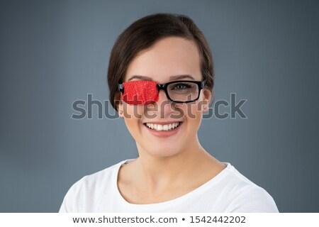 Donna occhiali pigro occhi Foto d'archivio © AndreyPopov