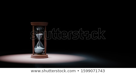 Clock Spotlighted on Black Background Stock photo © make