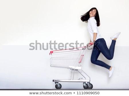 jonge · vrouw · winkelwagen · geïsoleerd · witte · winkelen · zwarte - stockfoto © vladacanon