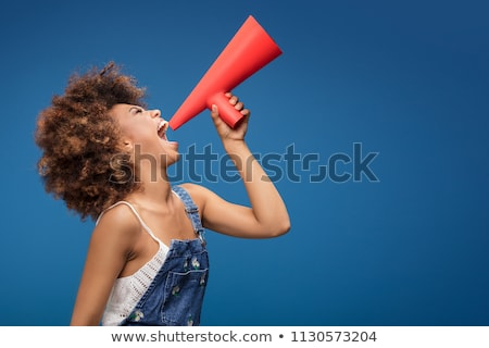 smiling girl speaking to megaphone Stock photo © dolgachov