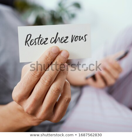 man showing the message i stay at home in french stock photo © nito