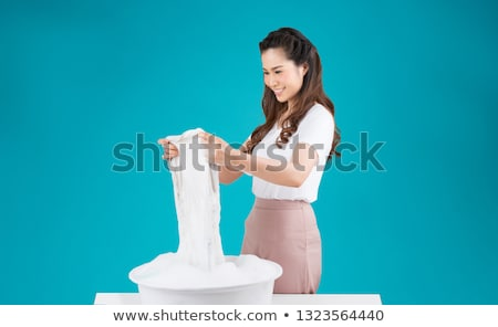 Donna lavaggio vestiti candeggina lavanderia colore Foto d'archivio © AndreyPopov
