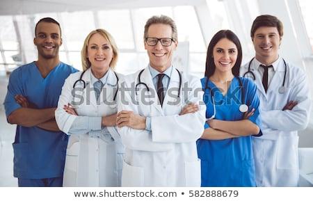 jonge · geslaagd · arts · medische · werken · ziekenhuis - stockfoto © zurijeta