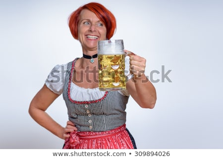 redhead woman in bavarian dress and a glass with beer stock photo © rob_stark