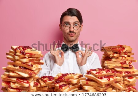 Portrait of adult man wearing formal clothes and glasses holding Stock photo © HASLOO
