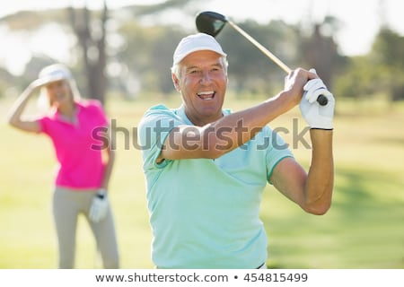 Stock photo: portrait of a couple in golf clothes