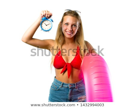 beautiful smiling woman in white bikini with alarm clock stock photo © get4net