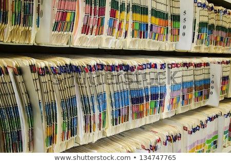lekarza · piśmie · schowek · recepcji · człowiek · szpitala - zdjęcia stock © photography33
