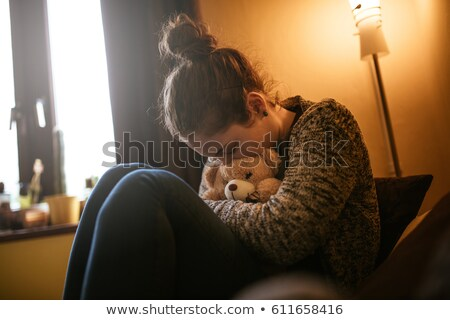 Teenage girl hugging cuddly toy Stock photo © photography33