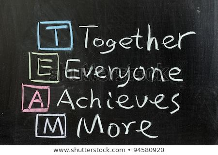 Acronym of TEAM on a blackboard Stock photo © bbbar