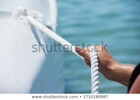 man · handen · omhoog · touw · achter · bars - stockfoto © andreykr