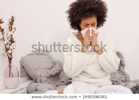 Sneezing girl. Stock photo © Kurhan