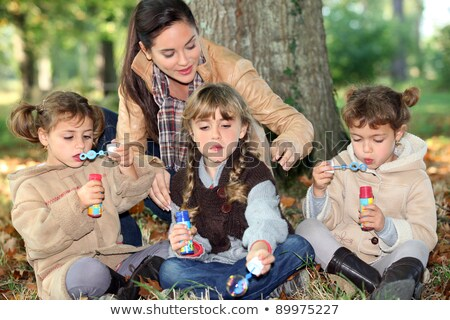 three little girls making bubbles in the forest stock photo © photography33