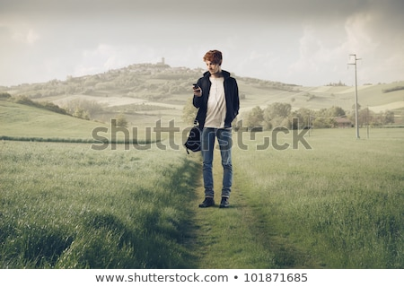 boy with phone on meadow stock photo © paha_l