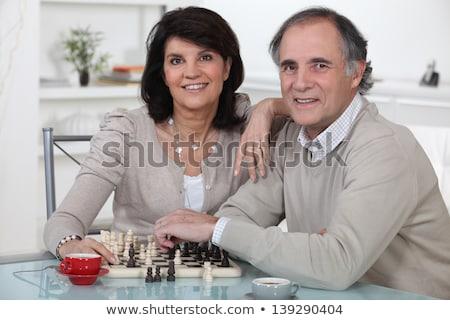 pareja · de · ancianos · jugando · ajedrez · casa · mujer · sonriente · ganar - foto stock © photography33
