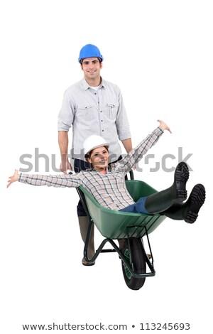 Builder couple using wheelbarrow Stock photo © photography33