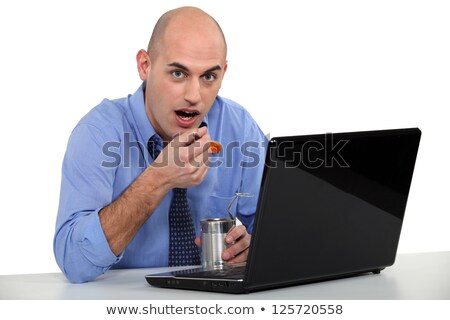 Man eating tinned food in front of his laptop Stock photo © photography33