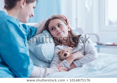 nurse caring for sick child stock photo © lisafx