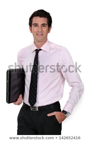 Stock photo: Businessman carrying laptop underarm