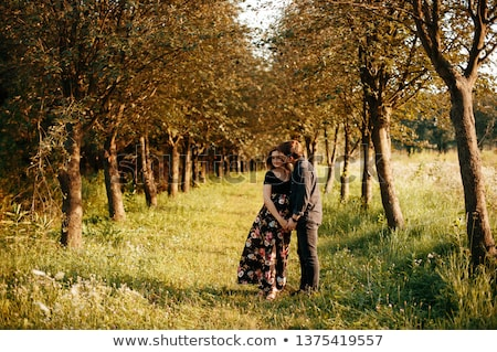 Stok fotoğraf: Young Couple Kissiing